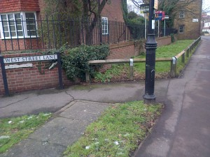 The Repaired Fence at the junction of West Street Lane with North Street