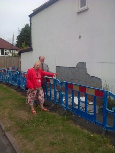 Jill and Alan inspect the crumbling render on the Milton Avenue pavement to the side of the house in Westmead Road