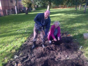 Alan and Jill planting bulbs (picture taken by Hamish)