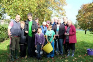 Residents and Carshalton Central ward councillors (and others) bulb planting in Benhill Rec
