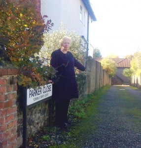 Cllr. Jill Whitehead at the entrance to Parker Close